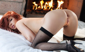 Penthouse Sabrina Maree 37287 Check out this awesome set of the ravishing redhead Sabrina Maree slipping off her black lacy lingerie and getting cozy naked in front of a roaring fireplace to warm her beautiful natural figure!