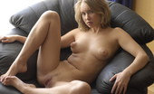 Met Art Koika Nausicaa by Slastyonoff Sexy blonde model with puffy nipples and blonde hair on a leather chair.