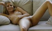 Met Art Iveta B Minarkos by Slastyonoff Stimulating blonde straddles a big tan sofa and loving it.