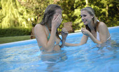 Met Art Iveta B & Yana B Palinis by Slastyonoff Two blondes strip naked and play together in a blue pool of passion.