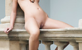Met Art Chiara A Ess by Erro Pretty Chiara straddles the ledge and beam with nothing but beads and heels on.