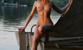 Met Art Daria A Sektas by Gribanov 39512 15.	Daria gets wet on a boat while exposing her hard, dark nipples and full grown bush in this outdoor shoot.