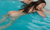 Met Art Sofia C Blu by Slastyonoff Long dark hair flows through water like a breeze as this pretty naked model swims.