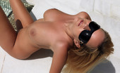 Met Art Raylene A Attention by Erro Giant images for this slick blonde with huge breasts and a beautiful tanned body.