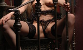 Met Art Katya N Erocs by Slastyonoff Brunette with classic model looks wearing fishnet stockings plays on the stairs and acts very naughty.