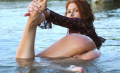 Met Art Lidiya A Transparent by Goncharov 41401 Young and tight Lidiya goes out doors to the river and  goes fishing for something without her panties.