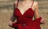 Met Art Emanuel A Exclusif by Maestro 45229 Wearing a red dress and a vivacious smile on her face, Emanuel enjoys flaunting her lean yet supple body, sprawling uninhibitedly on the grass and spreading her legs wide open.