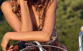 Met Art Mango A Calesma by Vlad Kleverov Fun, carefree and refreshingly cute, Mango exudes a pretty girl-next-door in her floral corset, skimpy pink skirt, and embellished sandals as she frolic on the grassy prairie with her bicycle.