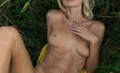 Met Art Taylor A Potenco by Alex Iskan With a confident, charming allure, Taylor is a stunning sight as she strips her hot yellow dress amidst the tall, verdant grass and tree.
