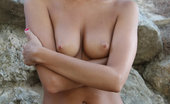 Met Art Mango A Plenumita by Vlad Kleverov 45862 With her charming, youthful allure, tanned complexion, beautiful firm breasts with puffy nipples, Mango's natural beauty stands out on a rocky location.