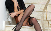Met Art Lisi A Senora by Goncharov 46271 Lisi looks stunning in her black cropped blazer jacket, brown high-waist skirt. Her thigh-high fishnet stockings and sparkly stiletto shoes perfectly showcases her beautiful, svelte legs. while a string of pearls and a stylish updo adds a touch of eleganc