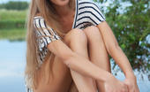 Met Art Lina Diamond Investice by Rylsky The beautiful Lina Diamond delivers a   gorgeous erotic outdoor shoot, strip   teasing her black and white stripe   shirt and poses on the dock by the   river.