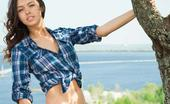 Met Art Nadine B Laurus by Alex Iskan 46622 Nadine slowly strips her denim jeans,   blue-checkered tank top as she   shamelessly bares her fresh and natural   body amidst the lush greeneries of the   outdoors.