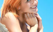 Met Art Violla A Anomia by Matiss Pretty redhead named Violla basks under the morning sun, her smooth skin is glowing, and her enchanting smile brighten up her beautiful face.