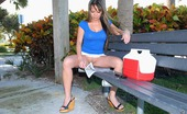 MILF Hunter Hot horny milf sitting on a park bench with no undies get picked up for some super hot fucking adventure sex pics
