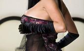 A tiny silk dress for busty brunette Audrey Bitoni