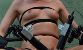 Fucking Machines Tori Black tied down and machine fucked with a power tool. She is stuffed full with a thick dong while bound leg spread and open.