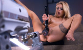 62298 Fucking Machines Muscle tight babe, trim and blond, shaved pussy, great legs gets machine fucked until she squirts from a BIG black cock.