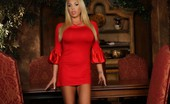 Mary Carey Gorgeous busty blonde, Mary Carey, is stunning in her red silk dress and heels.  Even better is when she strips down revealing her big tits and amazing body!