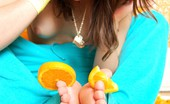 Ariel Rebel plays with sticky oranges naked