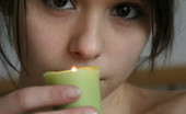 Ariel Rebel plays with candles