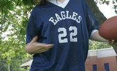 Sexy teen model in football jersey