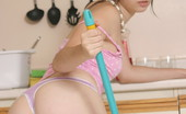 Sexy teen cleans the kitchen naked