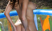 Bikini Riot Emily Addison Emily Addison popping out of pink bikini in inflatable pool