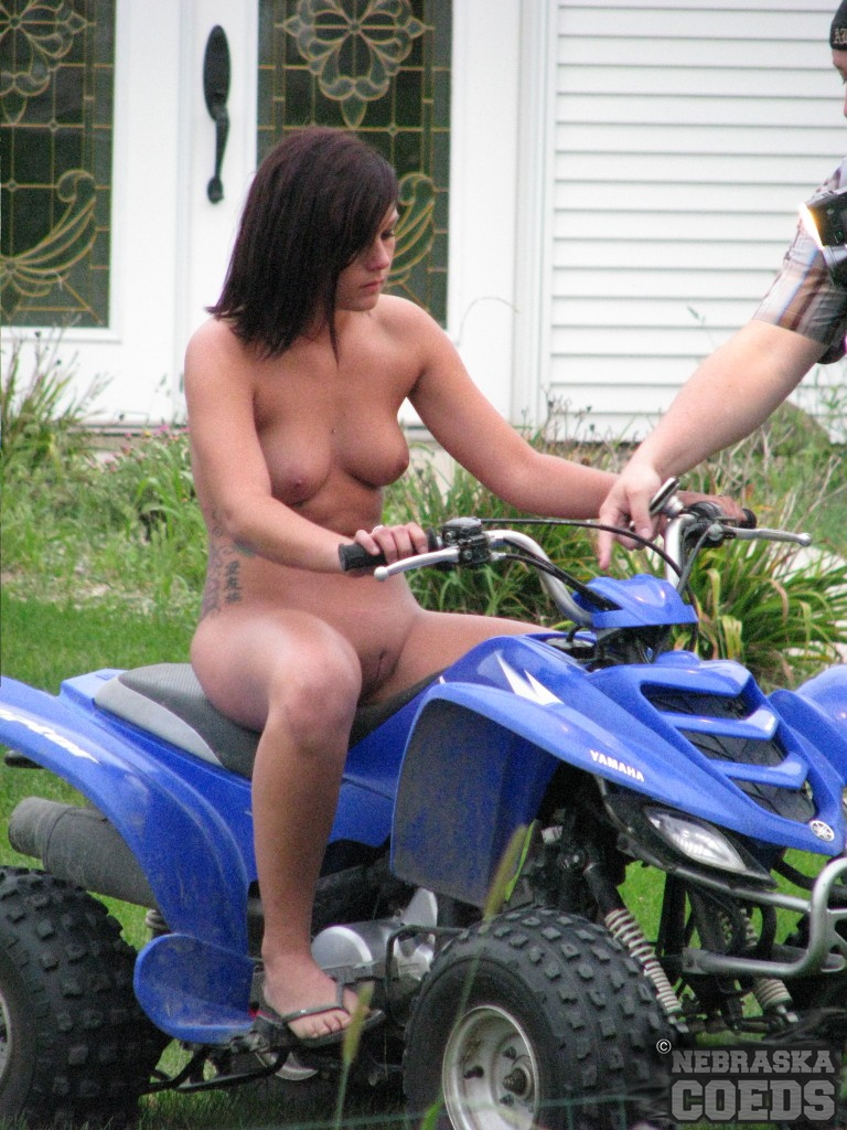 All Women riding atvs topless