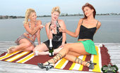 MILF Next Door  These 3 hot milfs are drinking champaign out on the dock and gettin frisky in these hot pics