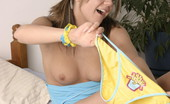 Andi Pink Sexy teen with a lollipop