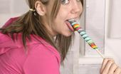 Andi Pink Cute teen model with lollipop