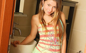 Emily 18 18 Takes Us To The Bathroom With Her Where She Removes Her Cute Outfit So You Can See Her Natural Tits And Her Smooth Young Ass. Teen Nude In Bathroom