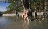 Amour Angels Natasha And Anna ANNA & NATASHA Amazing view of the trees and warm water make these cute lesbian girls remove clothes and start posing.