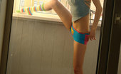 Amour Angels Dary DARY Pretty cute teen takes of her vest and panties posing shamelessly before cameras eye
