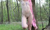 Amour Angels Luba LUBA PARK Leggy girl with perfect body walking in a woods and flashing her breasts before getting stripped