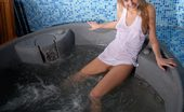 Amour Angels Lera RELAX An lnnocent looking teen girl getting in a tub in her white tank top, so it becomes wet and underlines her awesome breasts
