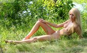 Amour Angels Olga SUMMER TIME Splendid striking teen has come to the picturesque green valley near the blue river to have a little rest without clothes.