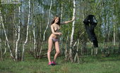 Amour Angels Lena FRESHNESS Smiling girl takes off her clothes so that to show her sweetest delights in the forest.