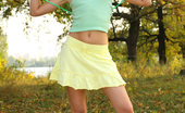 Amour Angels Alina EROTIC SPORT Slim teen girl takes off green top, yellow skirt and white panties.