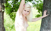 Amour Angels Snejana COLLEGE GIRL Delectable teen blonde enjoys a nice summer day outdoors posing totally nude on green grass.