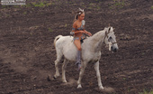 Amour Angels Sunna ANCIENT 106643 Extremely sensual petite teen girl rides a horse and artistically shows off her amenities.