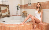 Amour Angels Snejanna CRYSTAL CLEAR VIDEO Enchanting slim girl sexually poses before soaking her gorgeous naked body in a hot bath.