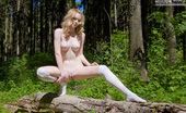 Amour Angels Violetta BELOVED Teen cutie with a tasty fresh body playfully poses in the woods wearing just high socks.