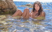 Amour Angels Indiana INACCESSIBLE Admirable pics of a gorgeous teenage beauty who passionately poses naked on the sea shore.
