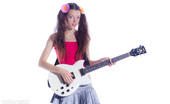 Amour Angels Sunny ROCK'N'ROLL Charming teen with electric guitar stripping and showing her perky tits and alluring holes.