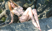 Amour Angels Aurora STONE AGE Soft skin, sunbathed hot cliff, a beautiful naked blonde. Adorable girl showing her astonishing delicate artistic loveliness.