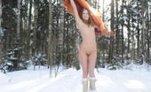Amour Angels Liza WINTER FOREST Lovely brunette posing in deep snow showing her breathtaking swollen nipples. Check out how she melts even an ice cold soul with her serenity.