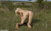 Amour Angels Sonia RED CHERRIES Check out this new softcore image set in which a lovely blonde teen sensually caresses her naked body on a field.