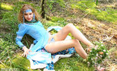 Amour Angels Lesya VESNA This image set is about a gorgeous blonde teen who takes off her blue dress to do a stirring tease show in the woods.
